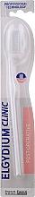 Parfums et Produits cosmétiques Brosse à dents, souple, 7/100, blanc - Elgydium Clinic 7/100