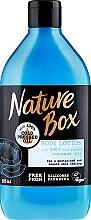 Parfums et Produits cosmétiques Lotion corporelle hydratante et lissante à l'huile de coco pressée à froid - Nature Box Coconut Body Lotion