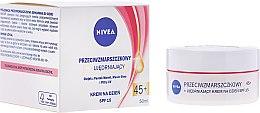 Parfums et Produits cosmétiques Crème de jour à l'huile de noyau d'abricot, SPF 15 - Nivea Anti-Wrinkle Firming Day Cream 45+