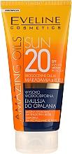 Parfums et Produits cosmétiques Émulsion solaire waterproof pour corps SPF20 - Eveline Cosmetics Amazing Oils
