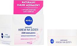 Parfums et Produits cosmétiques Crème de jour à l'huile d'amande douce - Nivea Moisturizing Day Cream Nourishing For Dry And Sensitive Skin