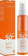 Parfums et Produits cosmétiques Lait en spray solaire hydratant pour corps SPF 50+ - Clarins Lait-en-Spray Solaire Corps 50+