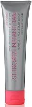 Parfums et Produits cosmétiques Lotion bronzante pour visage et corps, clair à moyen - St. Tropez Instant Tan Wash Off Face & Body Lotion Light/Medium