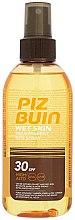 Parfums et Produits cosmétiques Spray solaire waterproof pour corps - Piz Buin Wet Skin Transparent Sun Spray SPF30